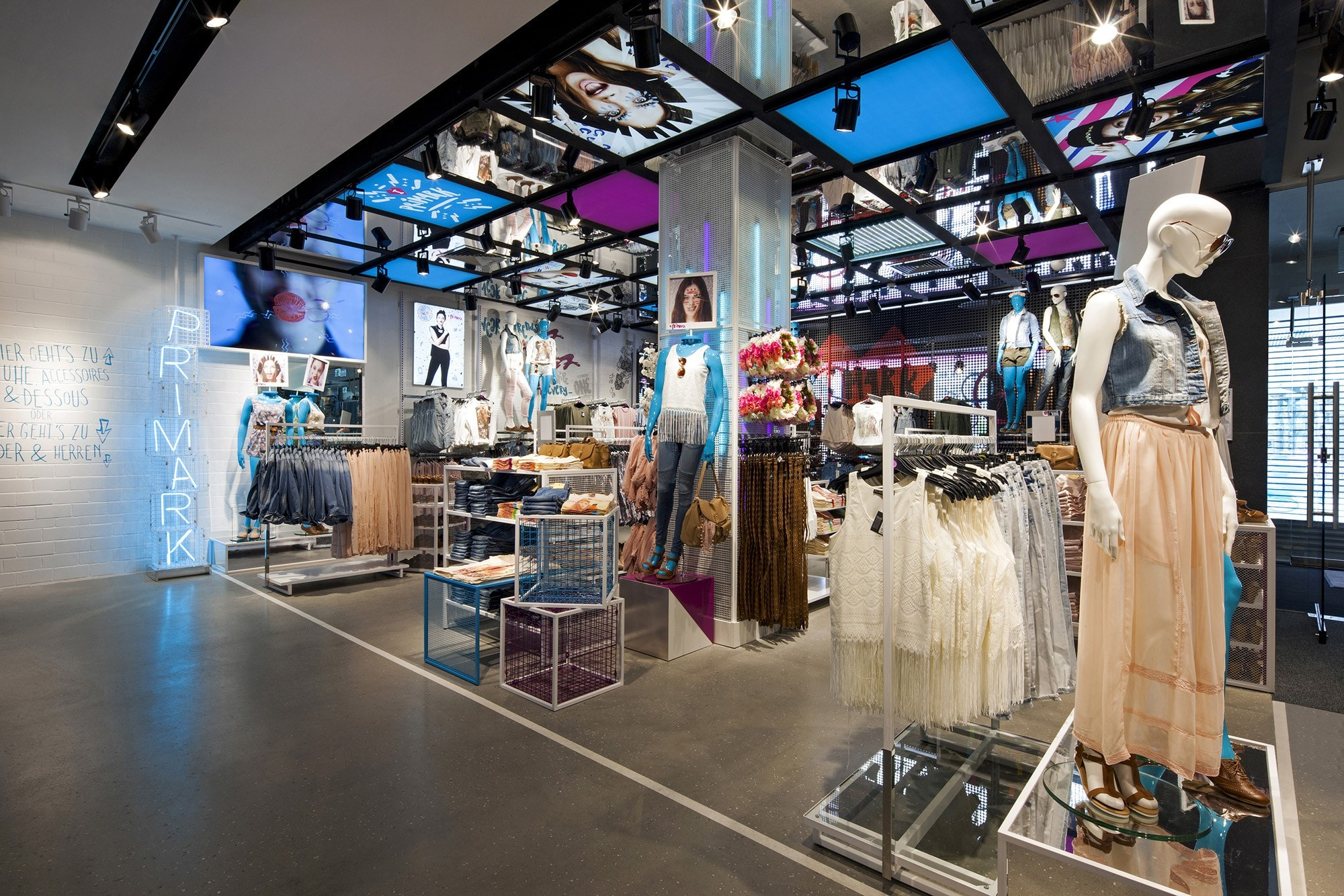 Primark women's clothing store with bright white and florescent lighting