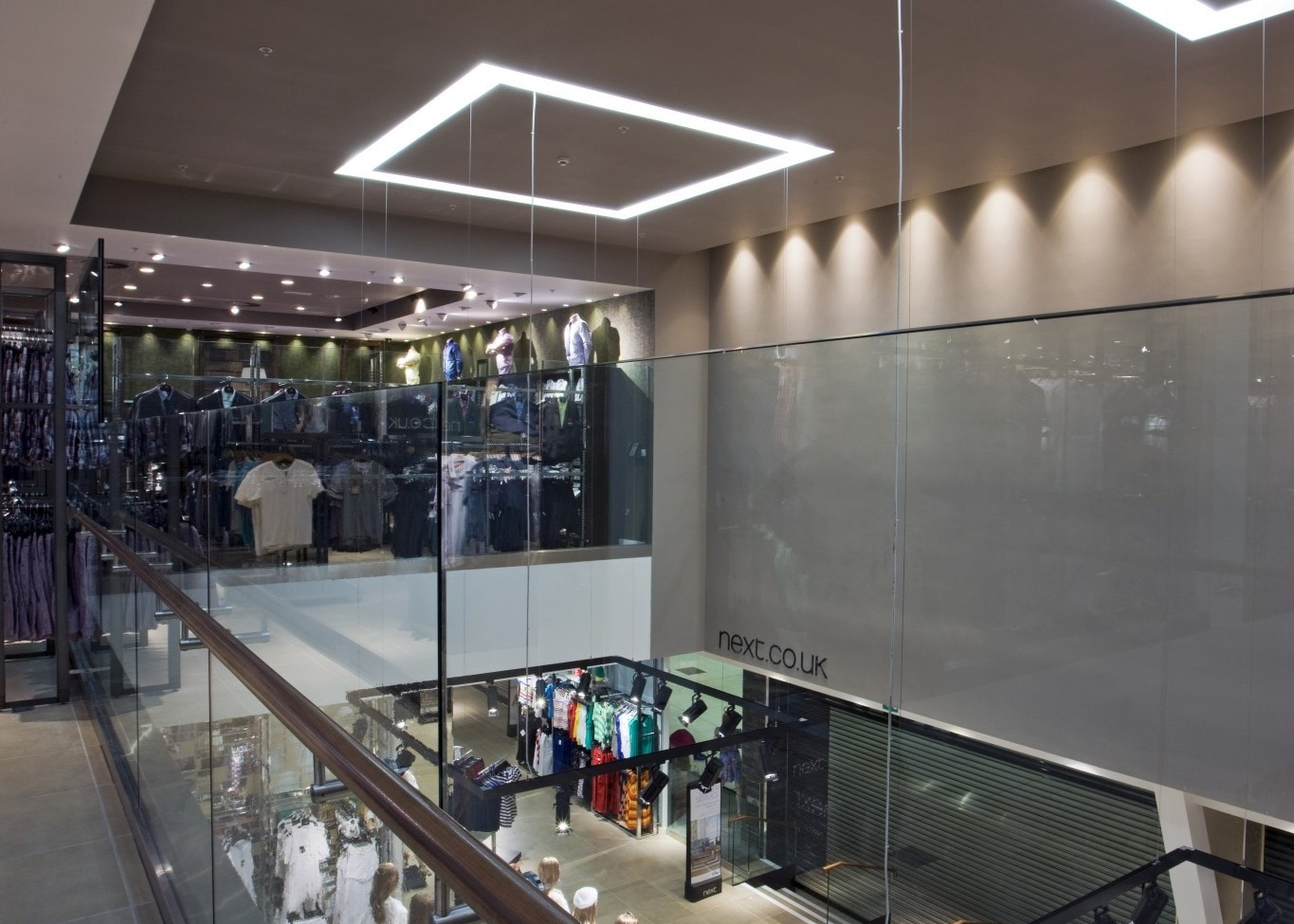 retail lighting design: Next upstairs view of ground floor