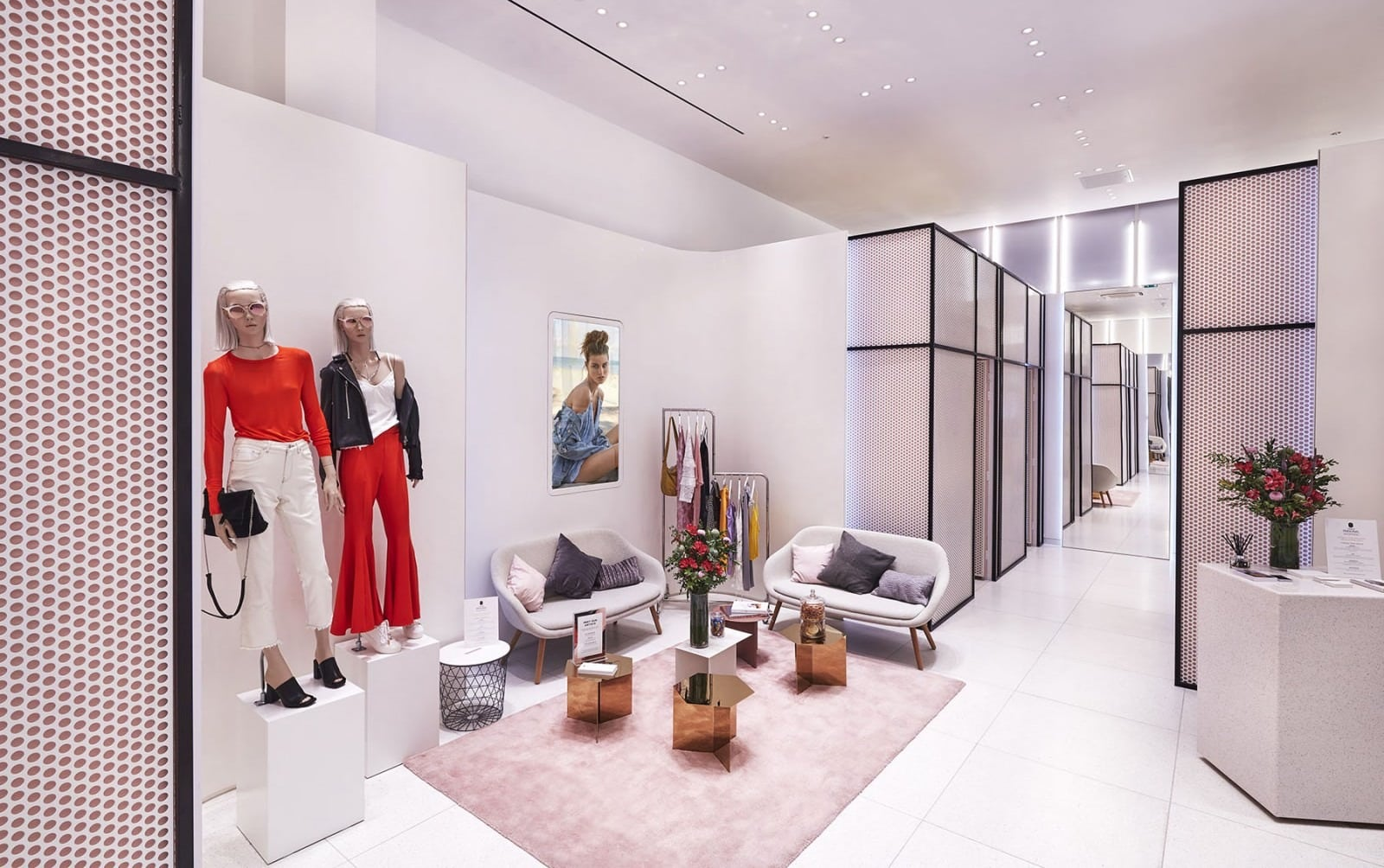 Topshop dressing room with seating area and mannequins - neutral lighting and interior