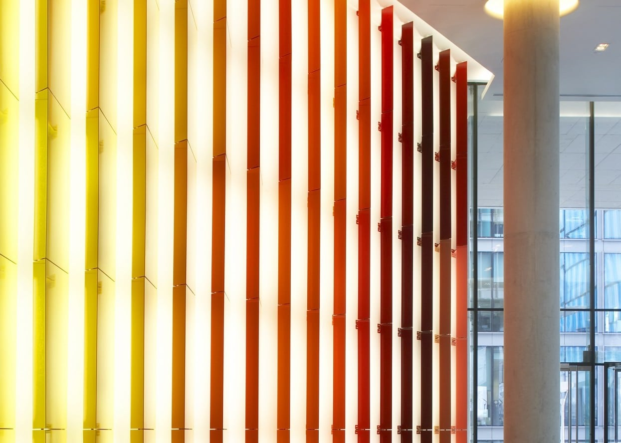 commercial lighting design: KPF Kingdom Street reception area with colourful window display