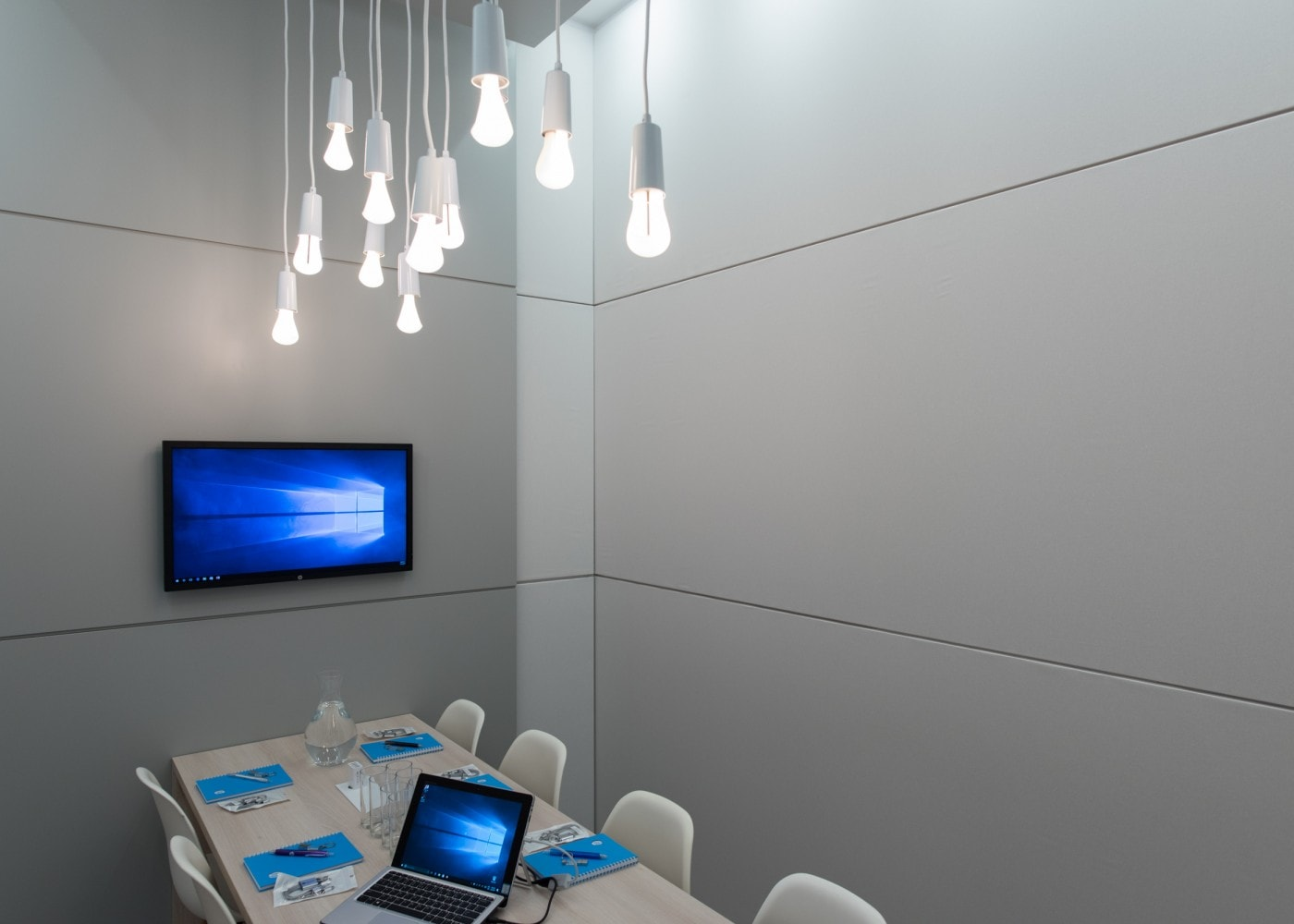 Modern office pod with falling string light-bulbs