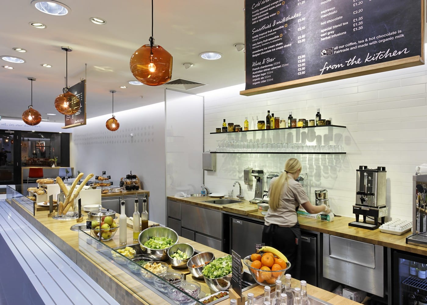hospitality lighting design: M&S cafe kitchen area