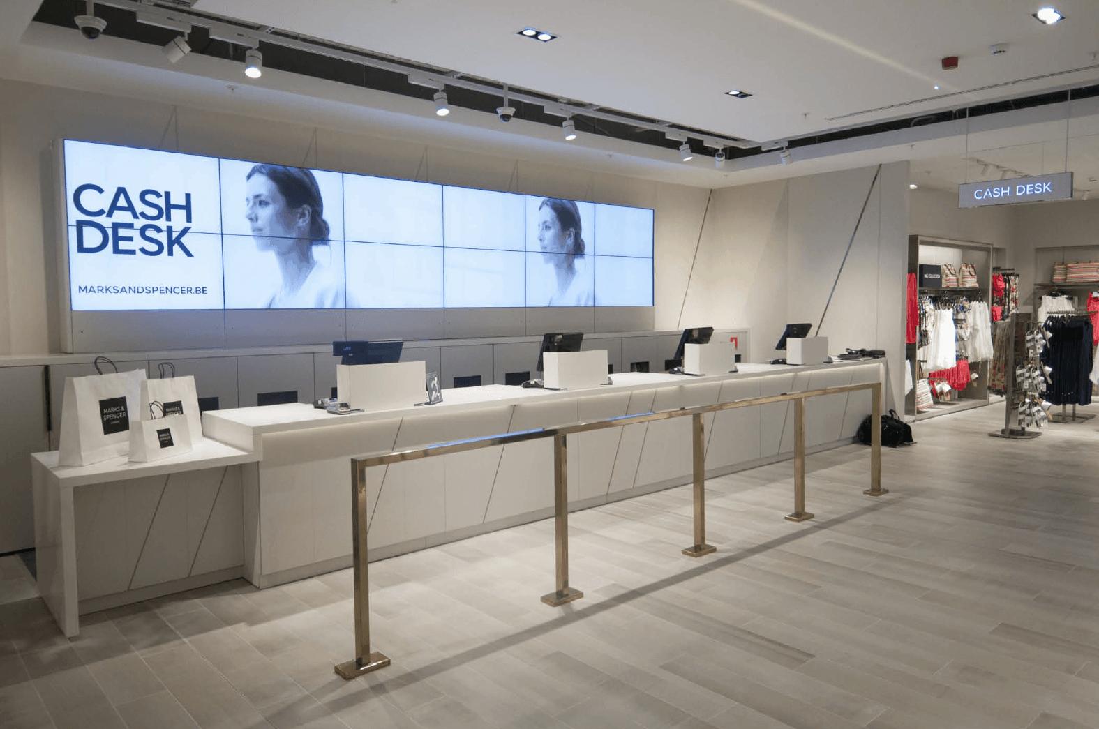 retail lighting design: M&S cash desk