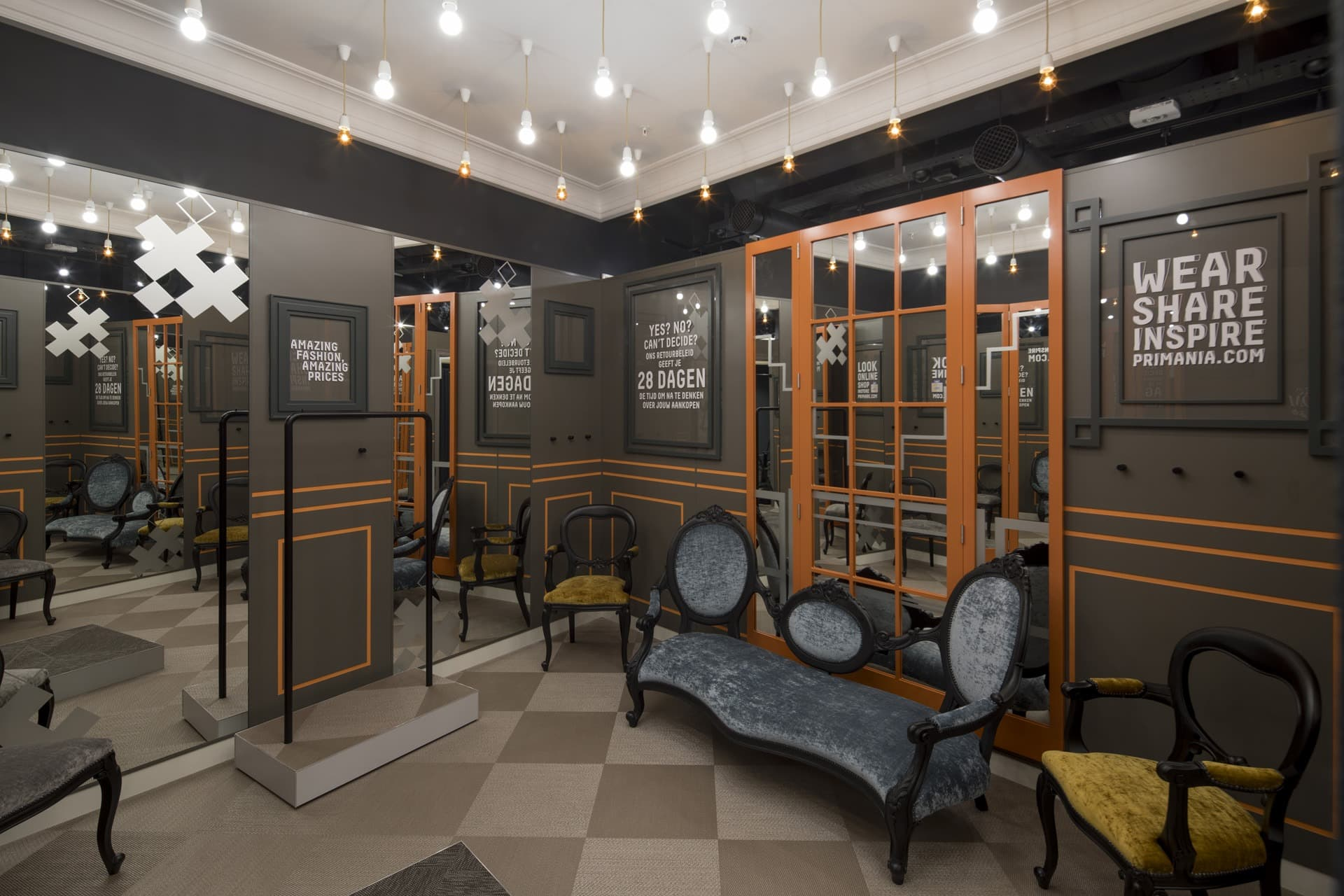 Men's dressing room with wall mirrors and handing ceiling bulbs