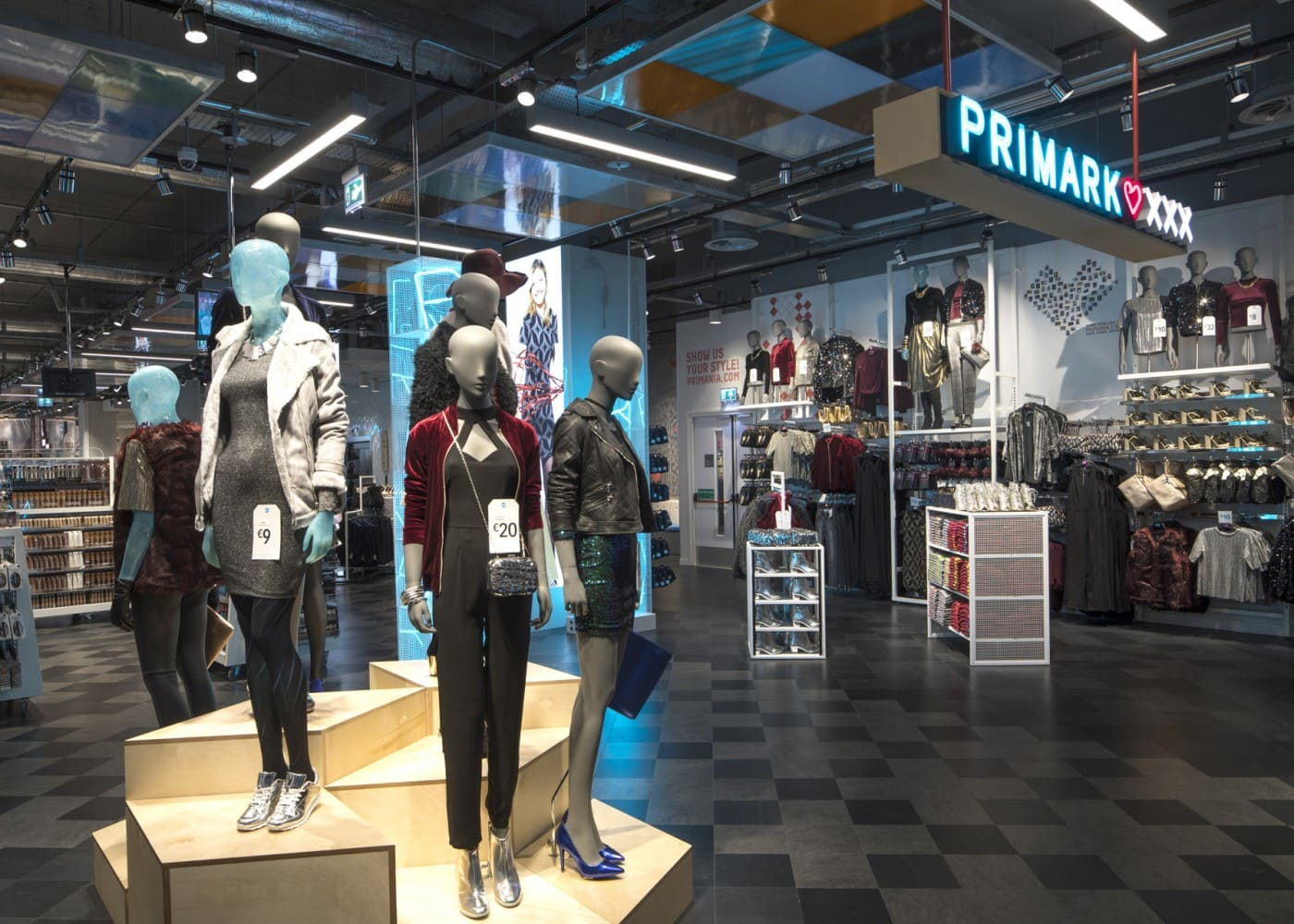 retail lighting design: Primark Amsterdam mannequins and store section