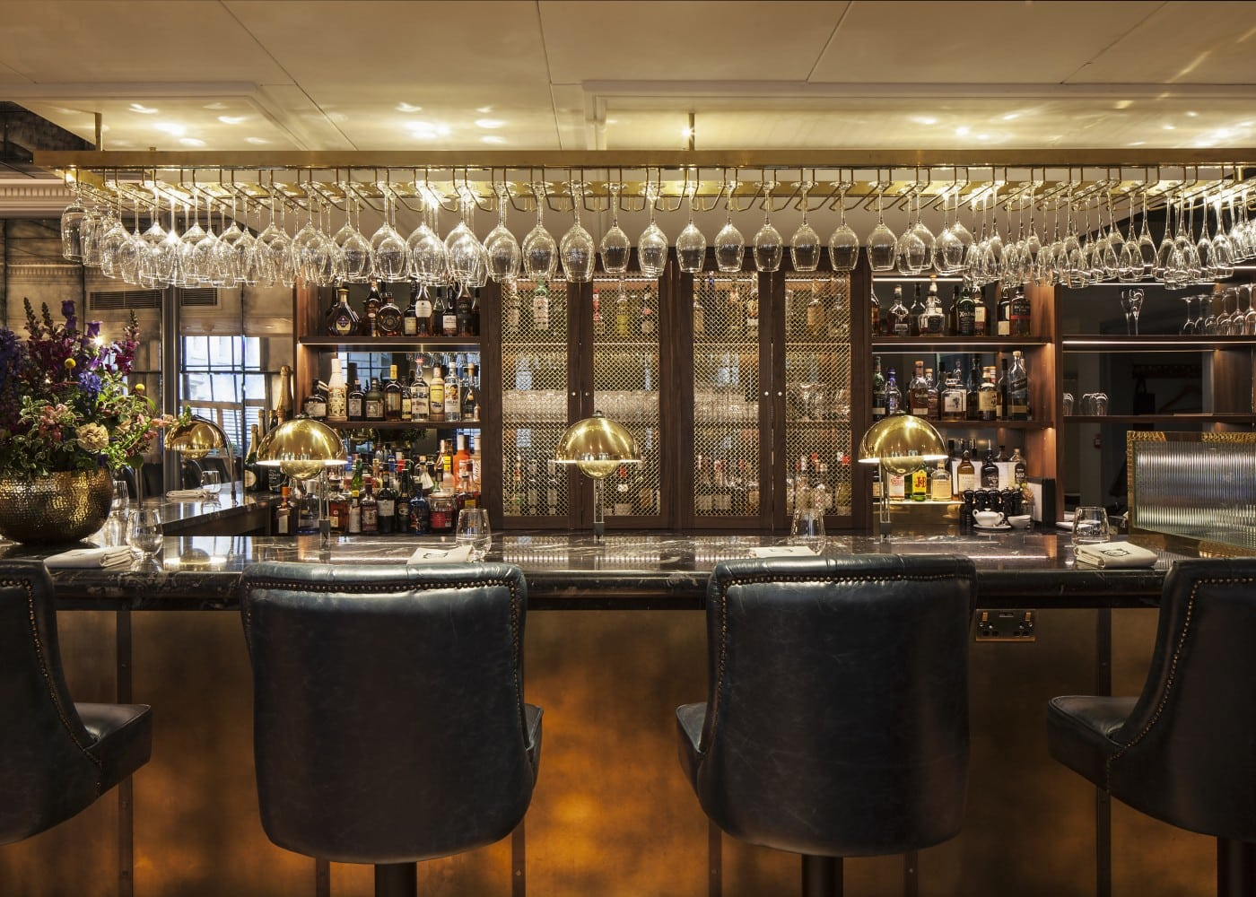 hospitality lighting design: bar at Dukes with dim lighting