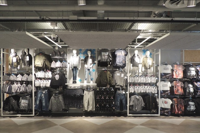 Track lighting used in clothing store
